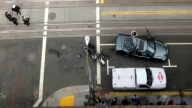 Crazy! San Francisco Window Washer Survives 11-Story Fall Onto Moving Car!